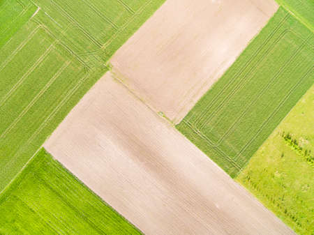 Landscape of cultivated fields from a bird's eye view. Agricultural landscape from the air. Abstract background. Standard-Bild