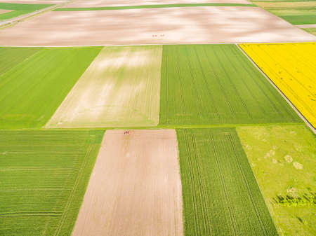 Agricultural landscape seen from the air. Colorful farmland seen from the bird's eye view. Standard-Bild