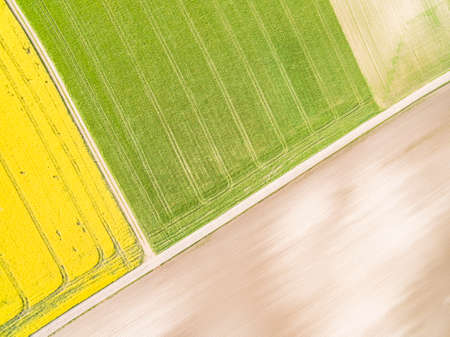 Farmland from a bird's eye view. Abstract background created of boxes. Agricultural landscape from a bird's eye view. Standard-Bild