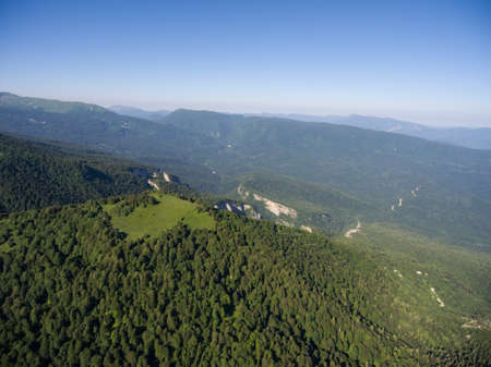 birdseye: Photos from the birds-eye view. The mountain ridge covered with forest. Mountain landscape. Caucasus.