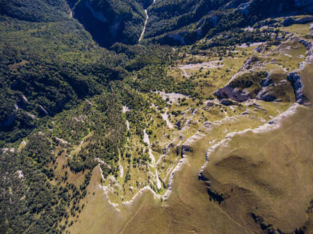 Top view of the precipice and the river in a mountain valley. 版權商用圖片