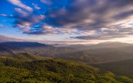 Aerial landscape. Forest and cloudy dramatic sky. Caucasus. Archivio Fotografico