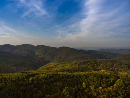 Aerial view. Landscape of mountain valley with autumn forest. Stock Photo