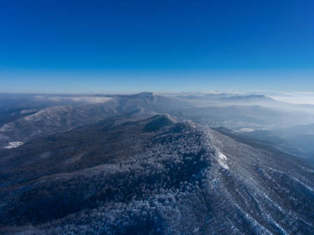 Aerial landscape of winter mountain valley. Russia. Stock Photo