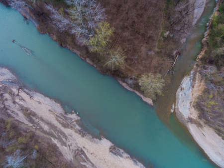 The confluence of two rivers. Top view of slanie rivers Pshekha and Tuha. Russia.