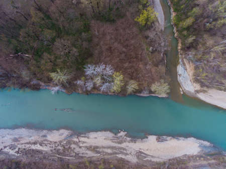 Aerial view to the small river flowing into a larger one. Stock Photo