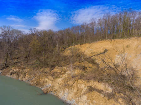 The steep clay slope of the riverbank. Drone photo.
