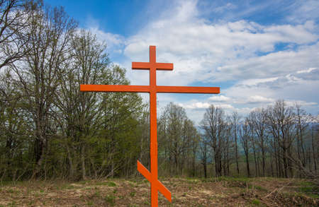 Iron memorial on the hill in the woods. Cross in memory of the victims of the second world war.