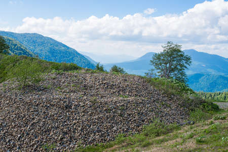 Pile of gravel under the open sky in the mountains.