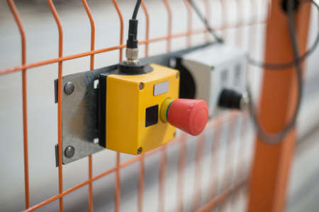 break chain: The red button is for emergency stop equipment. Stock Photo