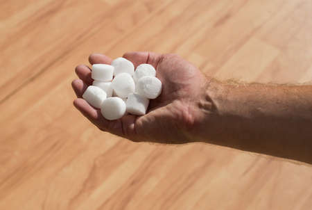 characteristic: Salt pellets for the water softener.