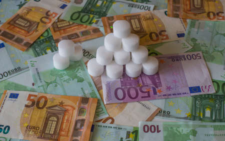 A bunch of salt tablets on the European money.