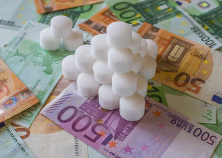 Salt pellets for the water softener on the background of Euro banknotes.