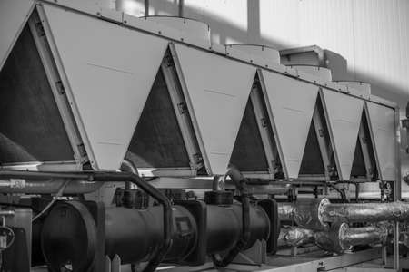 Industrial ventilation system of industrial facility. Black-and-white photo. Stock Photo