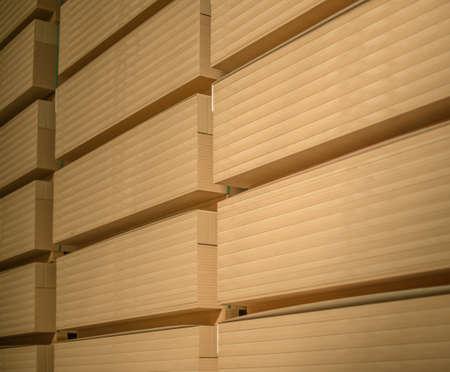 A stack of Medium Density Fibreboard (MDF). Selective focus.