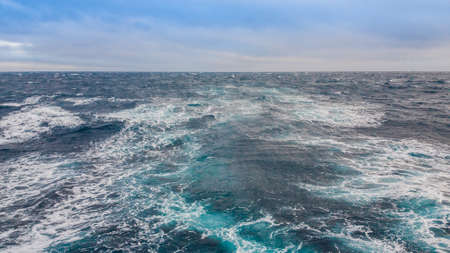 Seascape. The excitement of the water from the ship on the surface of the ocean. Stock Photo