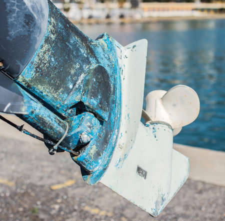 The lower part of the outboard motor. Selective focus.