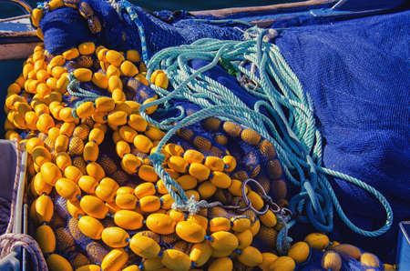 New fishing equipment. Yellow floats and blue fishing net. 免版税图像