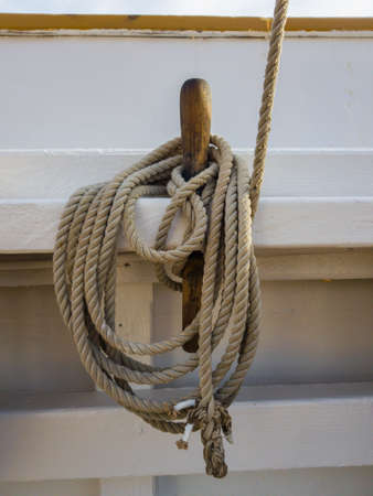 Nagel and coil of rope on the white board of the old schooner.