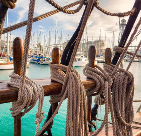 Pin rail with fixed ropes. An old sailing ship.