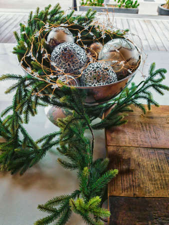 Christmas still life. Vase with Christmas balls and pine branches. Stockfoto