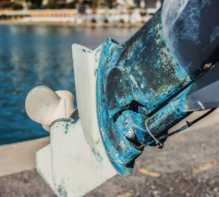Outboard motor standing on the shore. Selective focus. Stock Photo