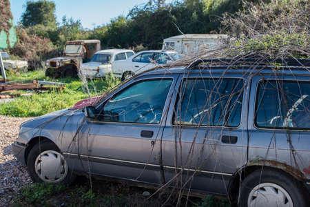 Abandoned old wagon in a car junkyard. 版權商用圖片