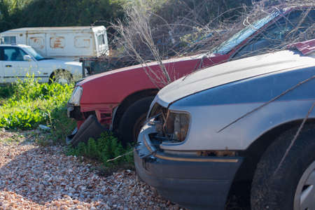 Dump of old cars in the countryside.