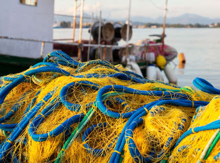 Fishing nets and fishing boat. Mediterranean sea, Greece, Preveza. 版權商用圖片