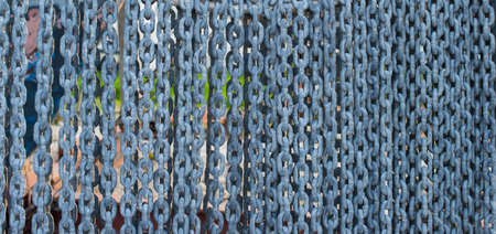 The anchor chain hangs in rows.