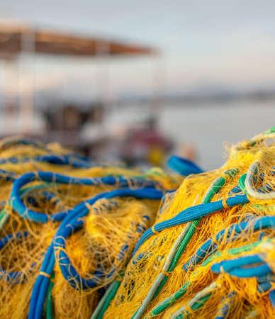 Fishing pier with nets at sunrise. Banco de Imagens