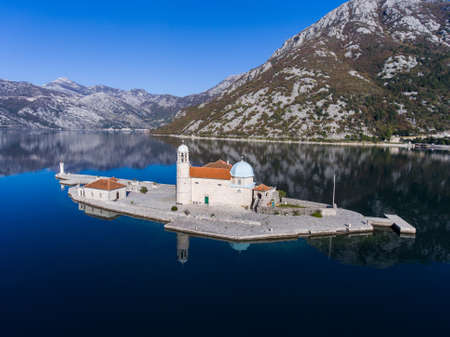 Calm in the Bay of Kotor. Aerial view of an island with a Church in the Adriatic sea.
