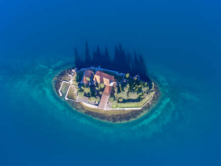 Top view from a drone on an island with a monastery in the Adriatic sea. Isle Saint George. 스톡 콘텐츠
