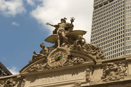 These are the statues of Poseidon, Athena and Mercury above the entrance of Grand Central, Manhattan, New York Stock Photo