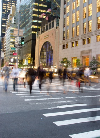Motion blur of people crossing Fifth Avenue in Manahattan, New York