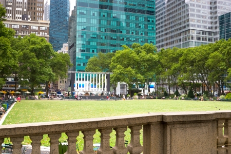 People relaxing in Bryant Park located in midtown Manhattan, New York Stock Photo