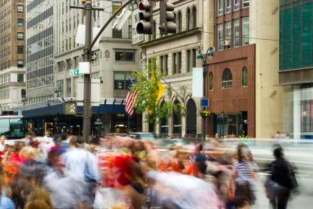 People rushing on 5th Avenue located in midtown Manhattan, New York Stock Photo