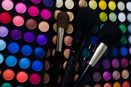 Makeup brushes on color palletes Stock Photo - 18326132