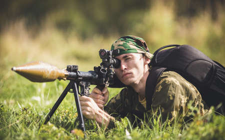 A man in military aims in sight of antiarmor weapon Stock Photo
