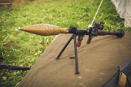 Front view at bazooka weapon against tanks lying on ground. Stock Photo