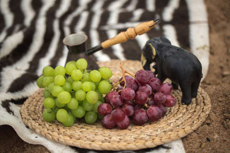 Grapes red and green on a straw napkin and Turku Stock Photo