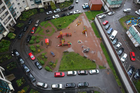 Parked cars in the courtyard of a block of flats in a new district of St. Petersburg. view from above.