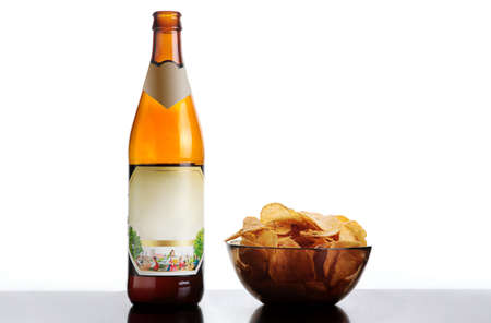 beer and potato chips. isolated on white.