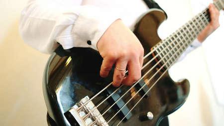 Guitarist playing of guitar. Close up shot Banco de Imagens