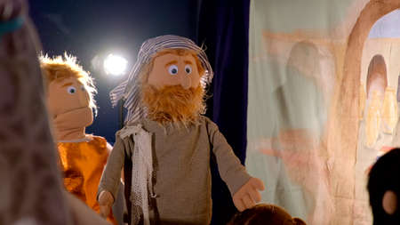Puppet theater playing Bible story: puppet man with beard and in typical Asian clothing