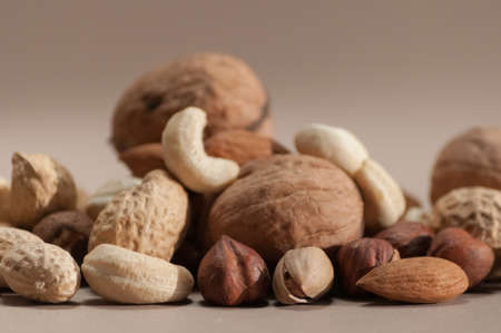 Different kinds of nuts on brown  photo