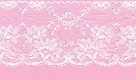 Beautiful  white floral lace on a pink background. photo