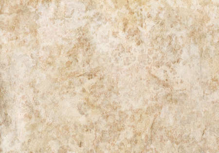 Old textured beige wallpaper.