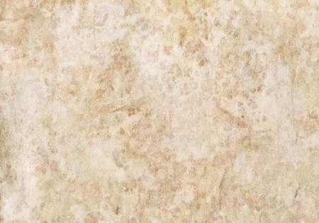 Old textured beige wallpaper.