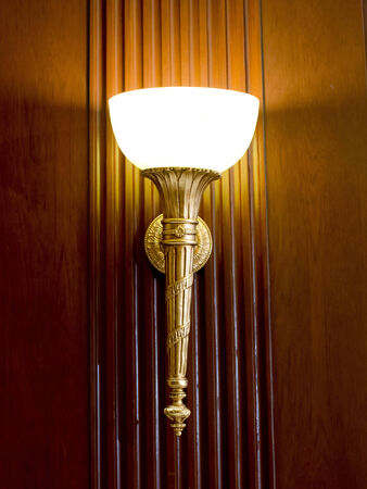 Lighted classic sconce on the wall Stock Photo - 23996589